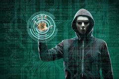 Anonymous computer hacker over abstract digital background. Obscured dark face in mask and hood. Data thief, internet. Attack, darknet fraud, dangerous viruses royalty free stock photography