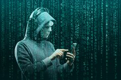 Anonymous computer hacker over abstract digital background. Obscured dark face in mask and hood. Data thief, internet. Attack, darknet fraud, dangerous viruses royalty free stock photo