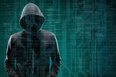 Anonymous computer hacker over abstract digital background. Obscured dark face in mask and hood. Data thief, internet. Attack, darknet fraud, dangerous viruses royalty free stock images