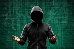 Anonymous computer hacker over abstract digital background. Obscured dark face in mask and hood. Data thief, internet. Attack, darknet fraud, dangerous viruses royalty free stock image