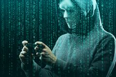 Anonymous computer hacker over abstract digital background. Obscured dark face in mask and hood. Data thief, internet. Attack, darknet fraud, dangerous viruses stock images