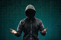 Anonymous computer hacker over abstract digital background. Obscured dark face in mask and hood. Data thief, internet. Attack, darknet fraud, dangerous viruses stock photo