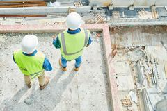 Anonymous construction engineers looking down stock image