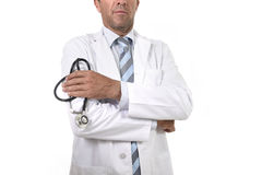 Anonymous crop face male medicine doctor holding stethoscope in his hand wearing medical gown royalty free stock images