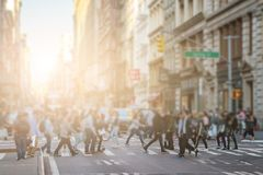 Free Anonymous Crowd Of People Walking Across The Intersection In SoH Stock Image - 110849291