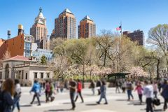 People walk through Union Square Park in New York City Royalty Free Stock Photos