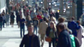 Anonymous crowd of people walking on street slow motion stock footage