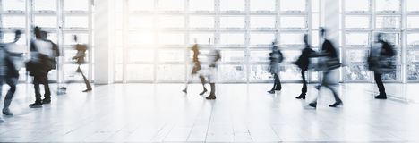 Anonymous crowd of people walking on a trade fair Royalty Free Stock Image