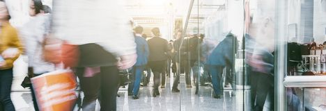 Anonymous crowd in a Shopping mall. Crowd of people rushing in a floor of a shopping center. ideal for websites and magazines layouts Royalty Free Stock Image