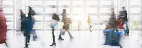 Anonymous crowd in a Shopping mall motion blur. Blurred Anonymous business crowd of people in in motion. ideal for websites and magazines layouts Stock Photography