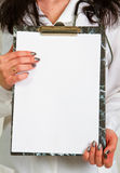 Anonymous doctor. Whit notepad a over white background Stock Photography