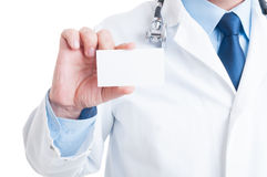 Anonymous doctor or medic showing blank business card Stock Images