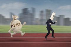 Anonymous escaping from debt Stock Images