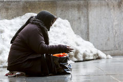 Anonymous female beggar Stock Photography