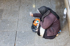 Anonymous female beggar Royalty Free Stock Image