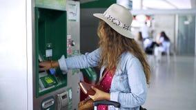 Anonymous female charging travel pass on station. Unrecognizable female charging travel pass while standing near modern machine on railway station stock video