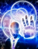 Anonymous figure radiates light. From hand Royalty Free Stock Image