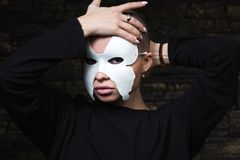 Shaved young model in mask stock photography