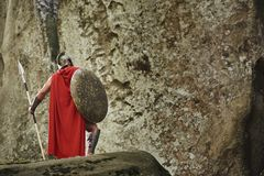 Anonymous gladiator on rocks Royalty Free Stock Photography