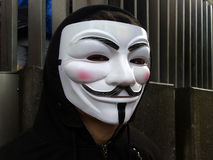 Anonymous group member wearing Guy Fawkes mask Royalty Free Stock Photos