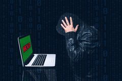 Anonymous hacked putting his hands on his head with much concern Stock Images