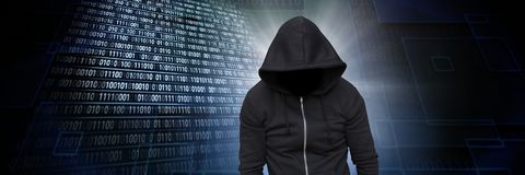 Anonymous hacker with computer code binary interface. Digital composite of Anonymous hacker with computer code binary interface stock images