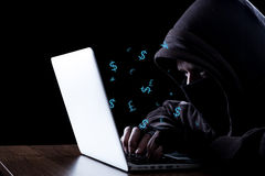 Anonymous hacker in the dark. Anonymous hacker with laptop in the dark. Cyber security concept Royalty Free Stock Image