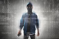 Anonymous hacker holding mobile phone. Unknown hacker holding mobile phone Stock Image