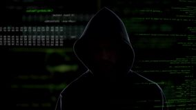 Anonymous hacker stealing secret corporate information, data system attack