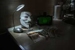 An anonymous hacker tries to crack the operating system`s protection Stock Photo
