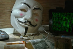 An anonymous hacker tries to crack the operating system`s protection Stock Images