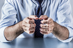 Anonymous hands of businessman showing, explaining, presenting or grasping something. Anonymous hands of businessman with a tie showing, explaining, presenting Royalty Free Stock Images