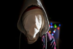 Anonymous head face in the hood maniac in dark situation f stock photography