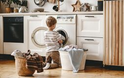 Free Anonymous   Householder Child Boy In Laundry   With Washing Machine Royalty Free Stock Image - 175653106