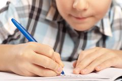 Anonymous kid doing homework Stock Images