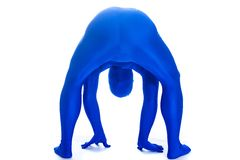 Anonymous man bent over looking back Royalty Free Stock Images