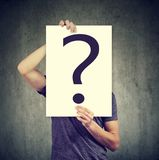 Anonymous man covering face with question mark Royalty Free Stock Photography