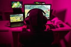 Anonymous man playing video game stock image