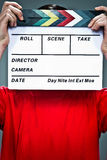 Anonymous Man with a Slate in Front of His Face Royalty Free Stock Image