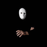 Anonymous mask. On black background royalty free stock photos
