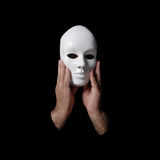 Anonymous mask. On black background royalty free stock images
