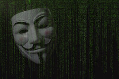Anonymous mask. And coding - cybercrime war stock images
