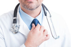 Anonymous medic or doctor fixing and adjusting the necktie Stock Images