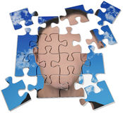 Anonymous mystery man blank face puzzle. Face of generic or mysterious anonymous man on a jigsaw puzzle Royalty Free Stock Images