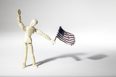 Anonymous patriotic American waving a USA flag Stock Photography