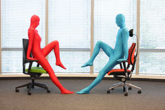 Anonymous people posture training  at chairs Royalty Free Stock Photos