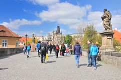 Anonymous people walking on Charles Bridge Royalty Free Stock Photography