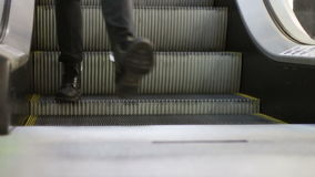 Anonymous People Walking on the EscalatorLift in Shopping Mall. Legs of Anonymous People walking on the escalator lift in Shopping Mall. People Groups and Crowds stock footage