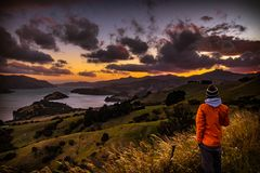 Anonymous person admiring view during sunset royalty free stock images