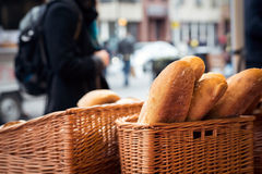 Anonymous person buying homemade bread at food market Royalty Free Stock Photos